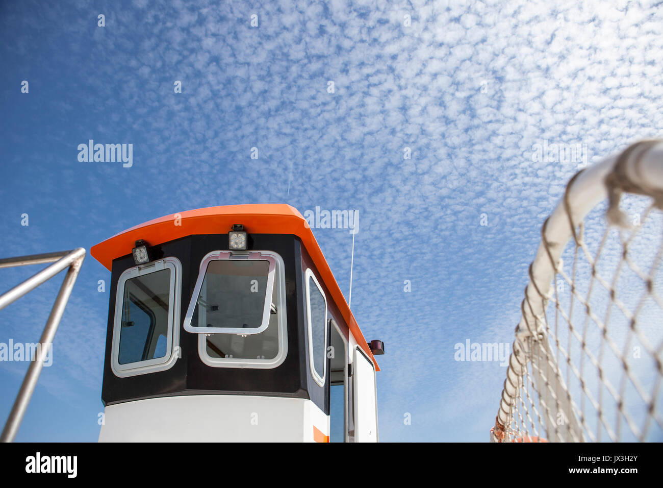 Ferry cockpit with cloud formations in the sky called Altocumulus floccus, El Rompido Cartaya, Huelva, Spain - Stock Image