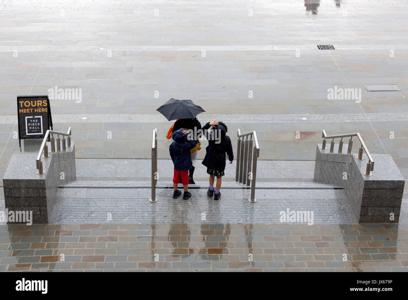 The Piece Hall in the rain, Halifax, West Yorkshire - Stock Image