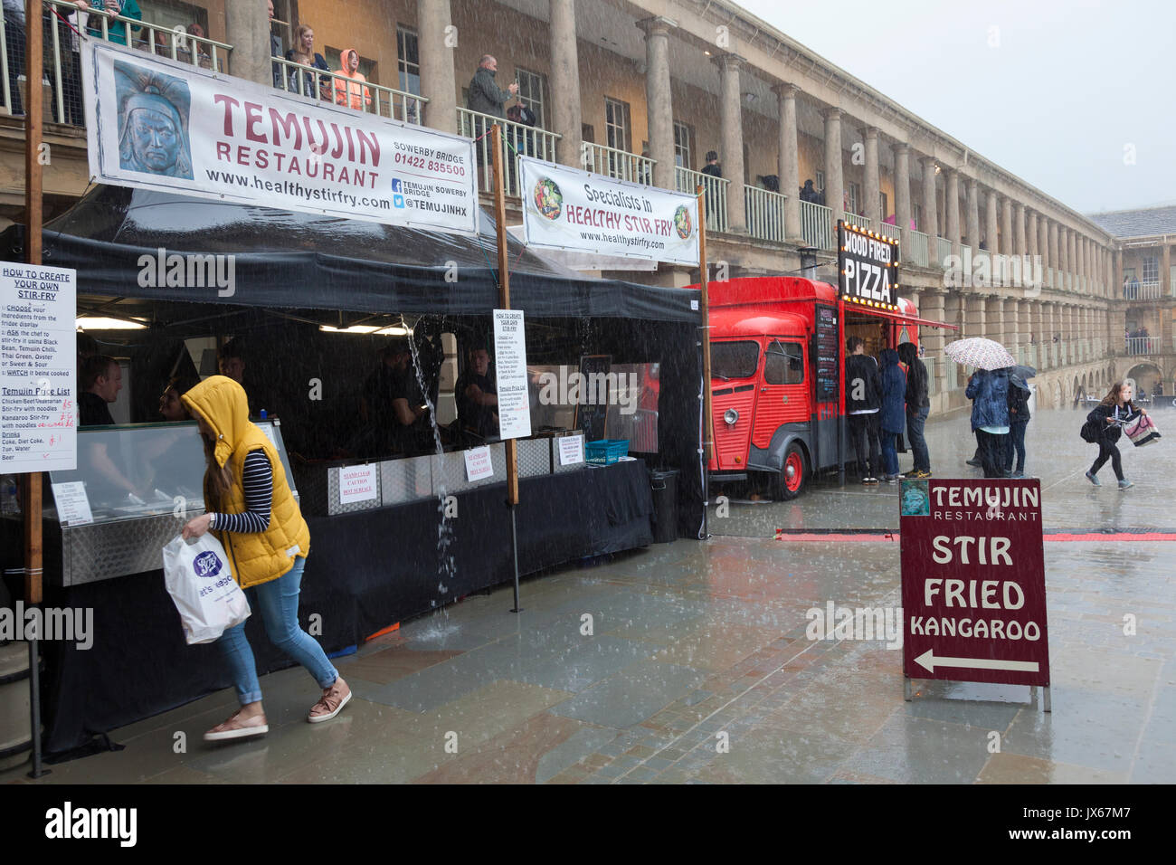 Food stall at the Piece Hall in the rain, Halifax, West Yorkshire - Stock Image