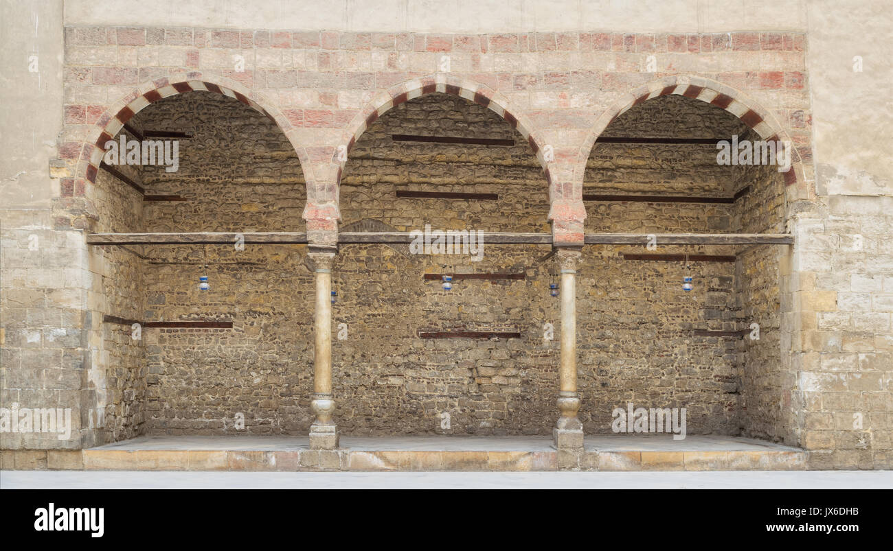 Three adjacent arches on stone wall, Medieval Cairo, Egypt - Stock Image