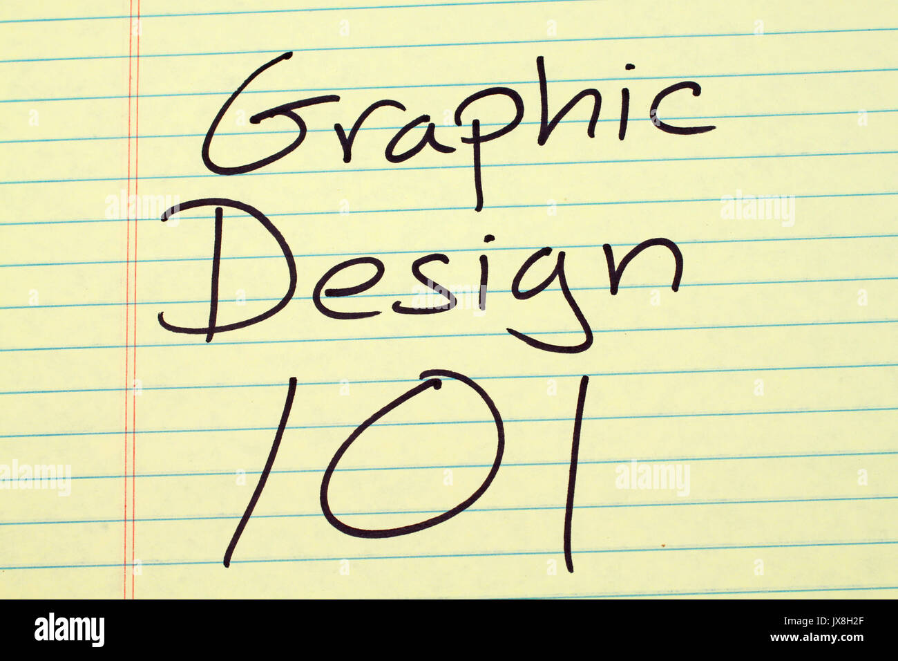 The words 'Graphic Design 101' on a yellow legal pad - Stock Image