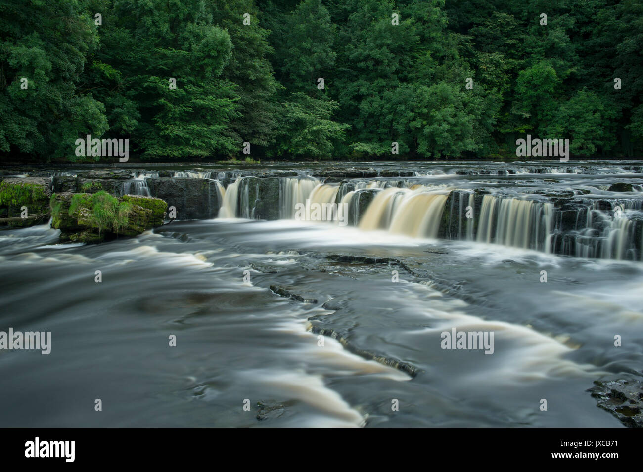 The Famous Aysgarth Falls Waterfall (Upper Falls) near Hawes in The Yorkshire Dales National Park, North Yorkshire, - Stock Image