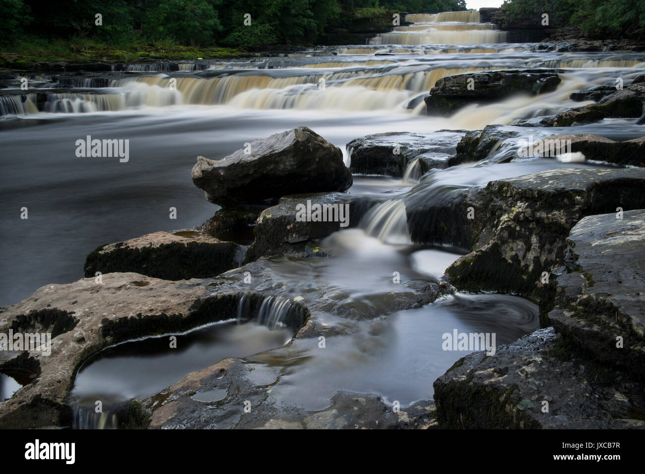 The Famous Aysgarth Falls Waterfall (Lower Falls) near Hawes in The Yorkshire Dales National Park, North Yorkshire, - Stock Image