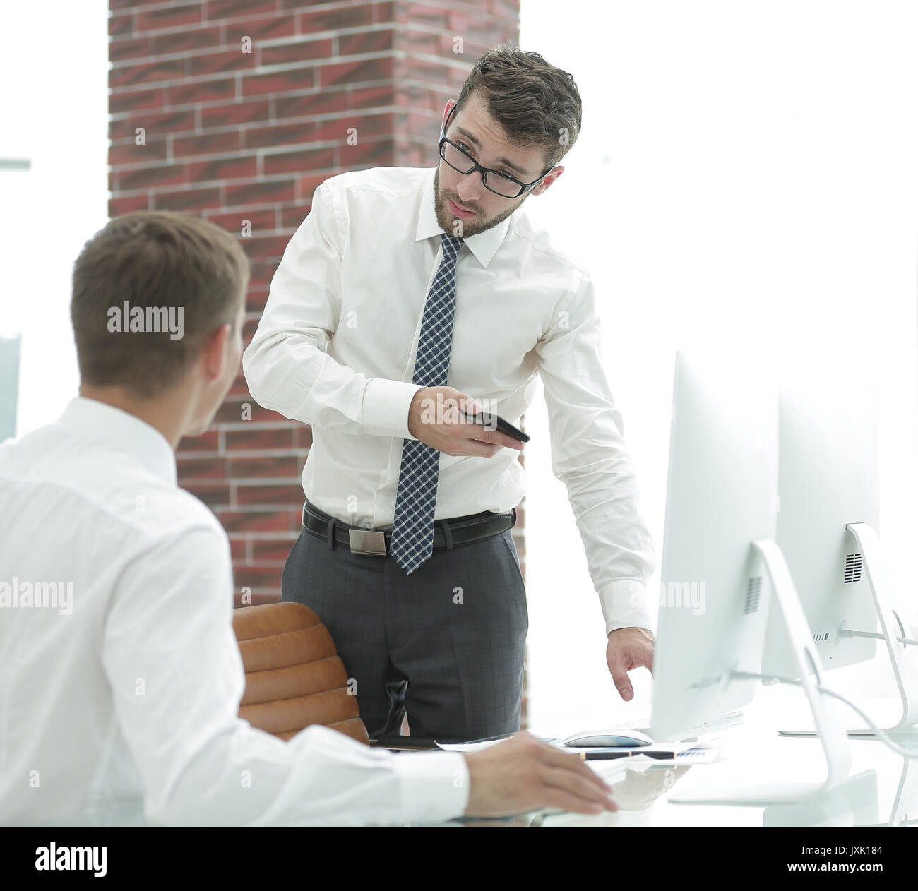 businessman decides to work problems - Stock Image
