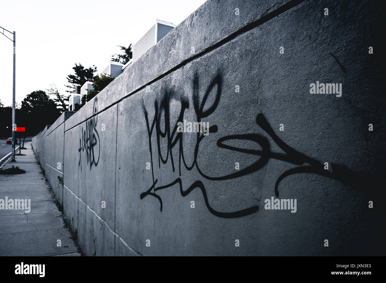 Minimalist urban graffiti on a gray day. - Stock Image