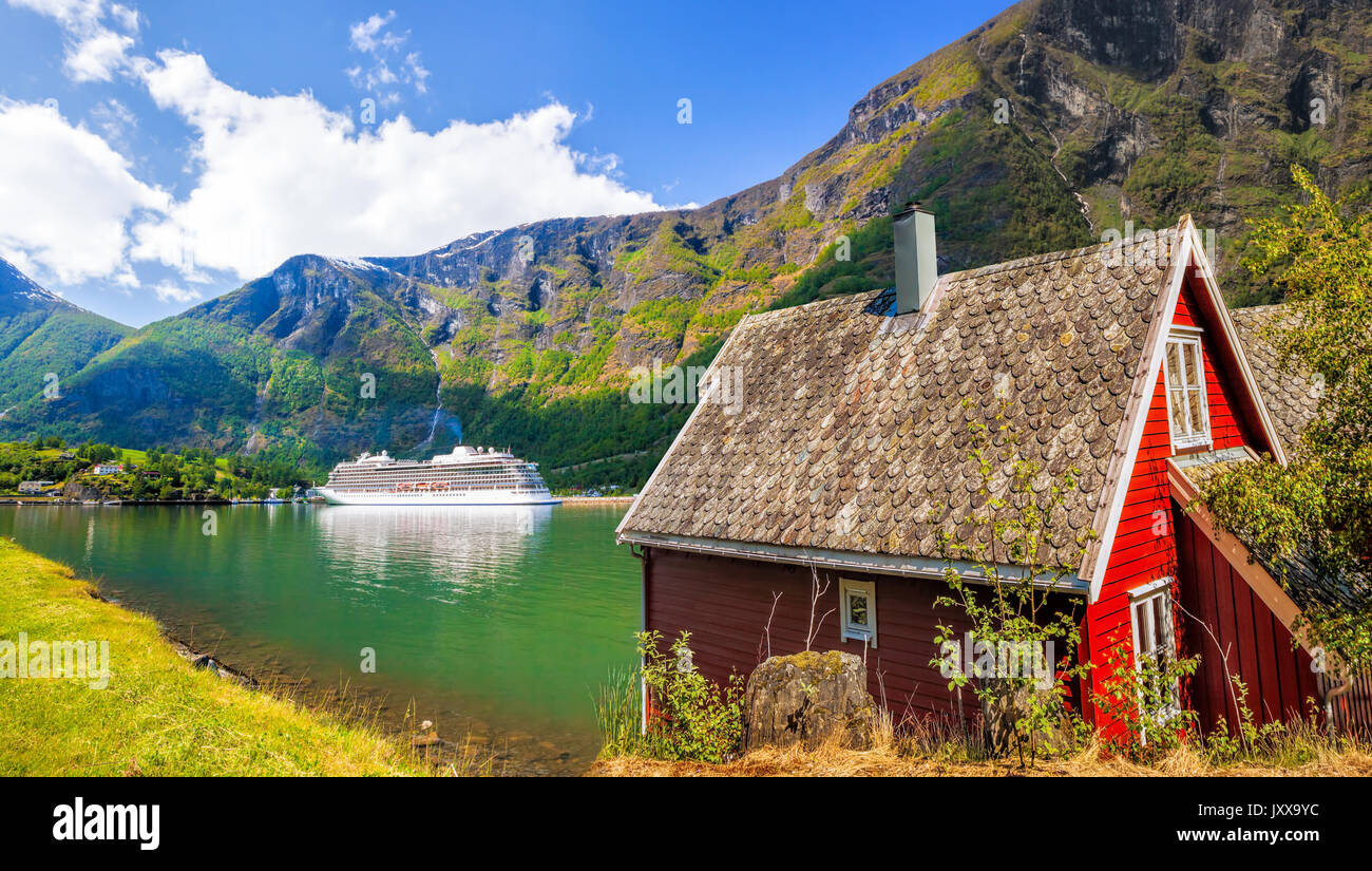 Red Cottage Against Cruise Ship In Fjord Flam Norway