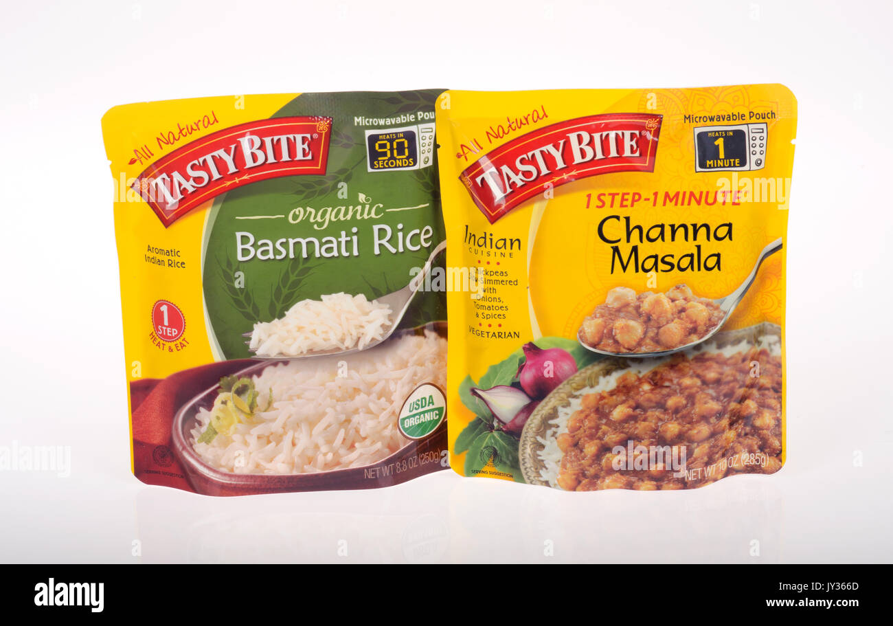 Unopened Packages of Tasty Bite prepared foods organic basmati rice and channa marsala on white background. USA - Stock Image