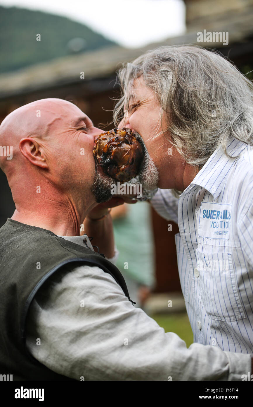 Two friends that contend a pork knuckle - Stock Image