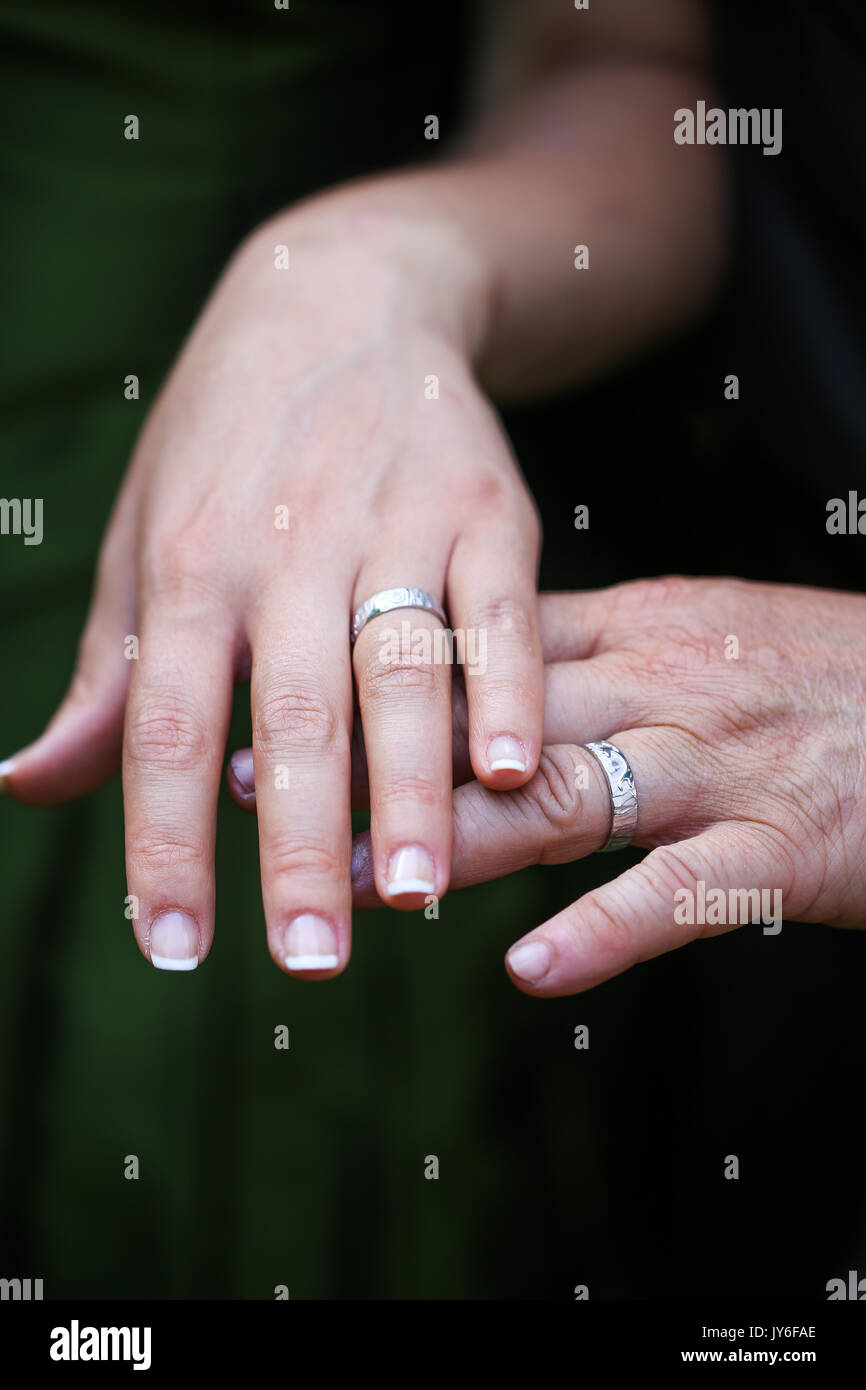 A couple wearing their wedding rings - Stock Image