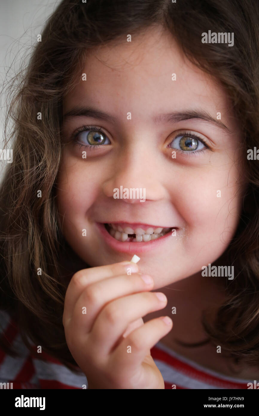 My tooth is loose! The First Loose Tooth - Stock Image