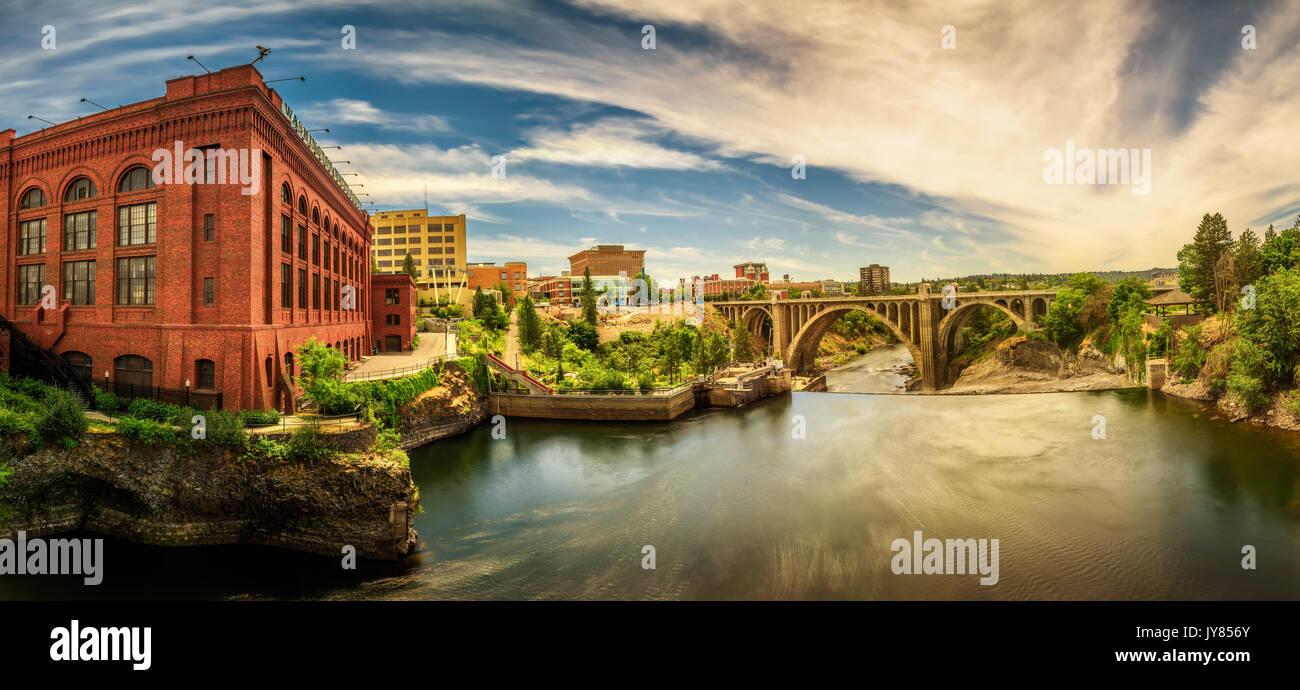 Panoramic cityscape view of Washington Water Power building and the Monroe Street Bridge along the Spokane river, - Stock Image