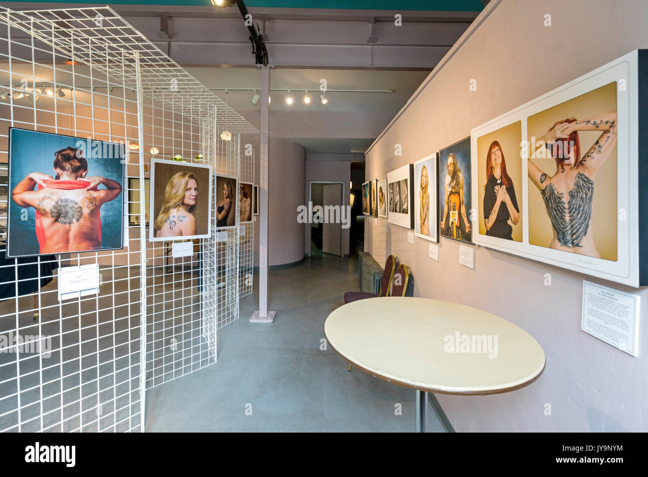 Photographic Gicleé prints of tattooed people; Paquette Gallery; SteamPlant Event Center; Salida; Colorado; - Stock Image