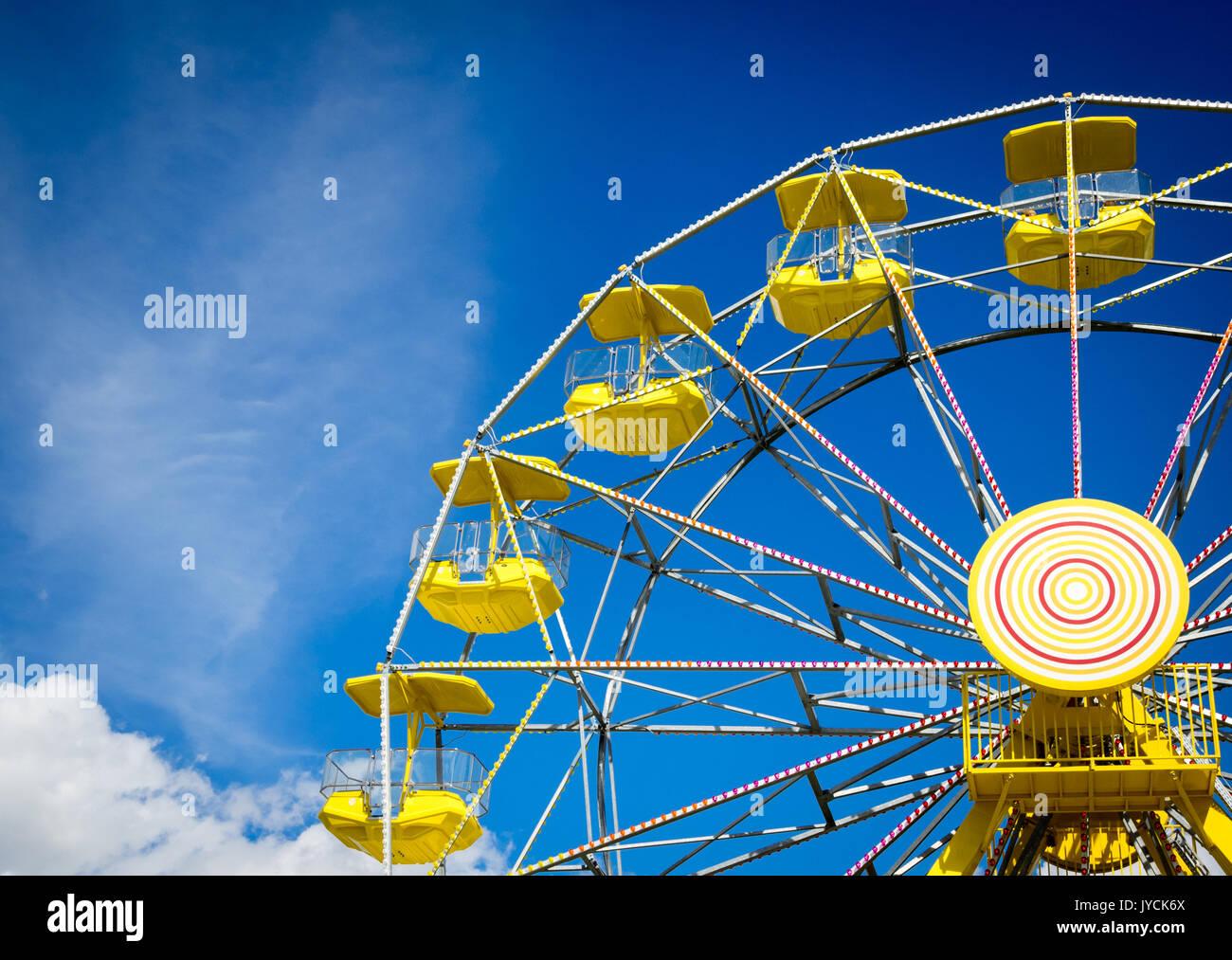 The yellow ferris wheel at the PotashCorp Playland at Kinsmen Park in Saskatoon, Saskatchewan, Canada. - Stock Image