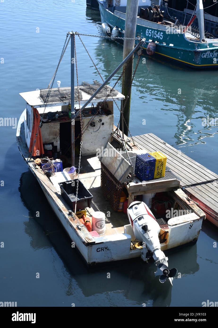 Harbor fishing boat motor stock photos harbor fishing for Fishing boat motor