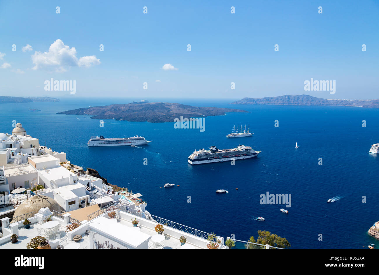 Cruise liners moored in the caldera at Fira (Thira, Thera) capital of Santorini, a Greek island in the Cyclades - Stock Image