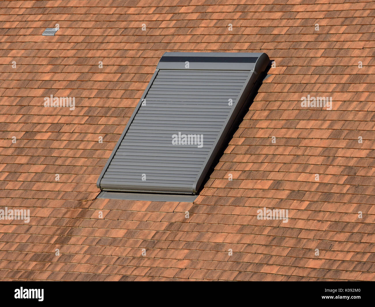 Velux roof-light window with blind closed. - Stock Image