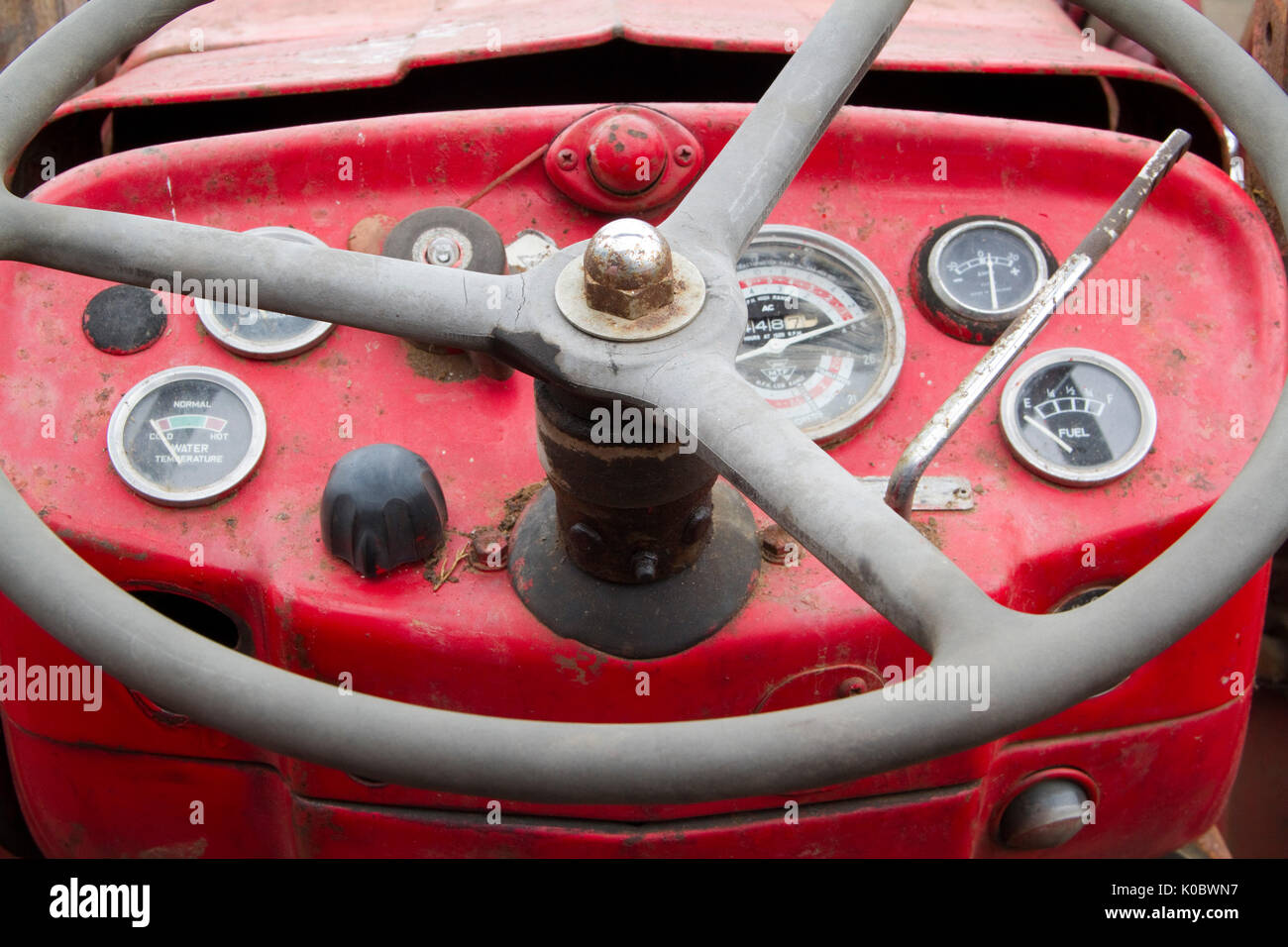 Steering wheel and instruments on an old tractor - Stock Image