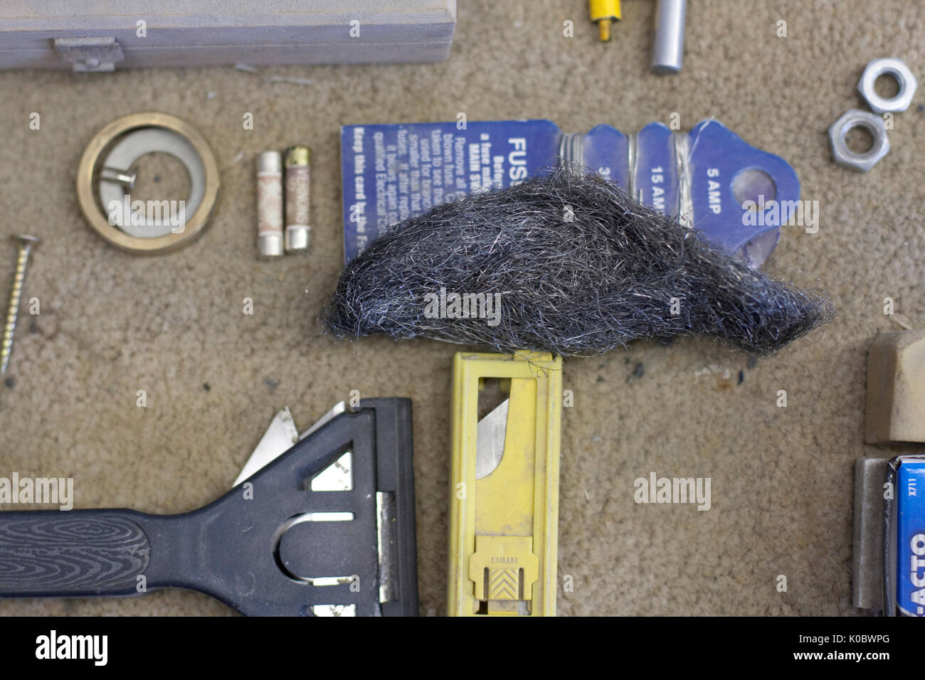 Assorted tools on a workbench - Stock Image