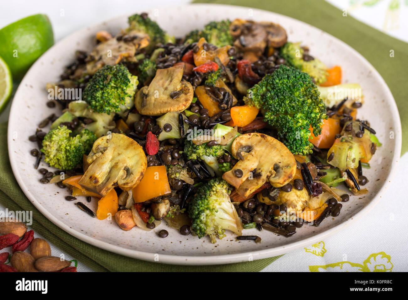 Closeup  shot of healthy Vegan Mix of Broccoli Wild Rice and Lentils dish - Stock Image
