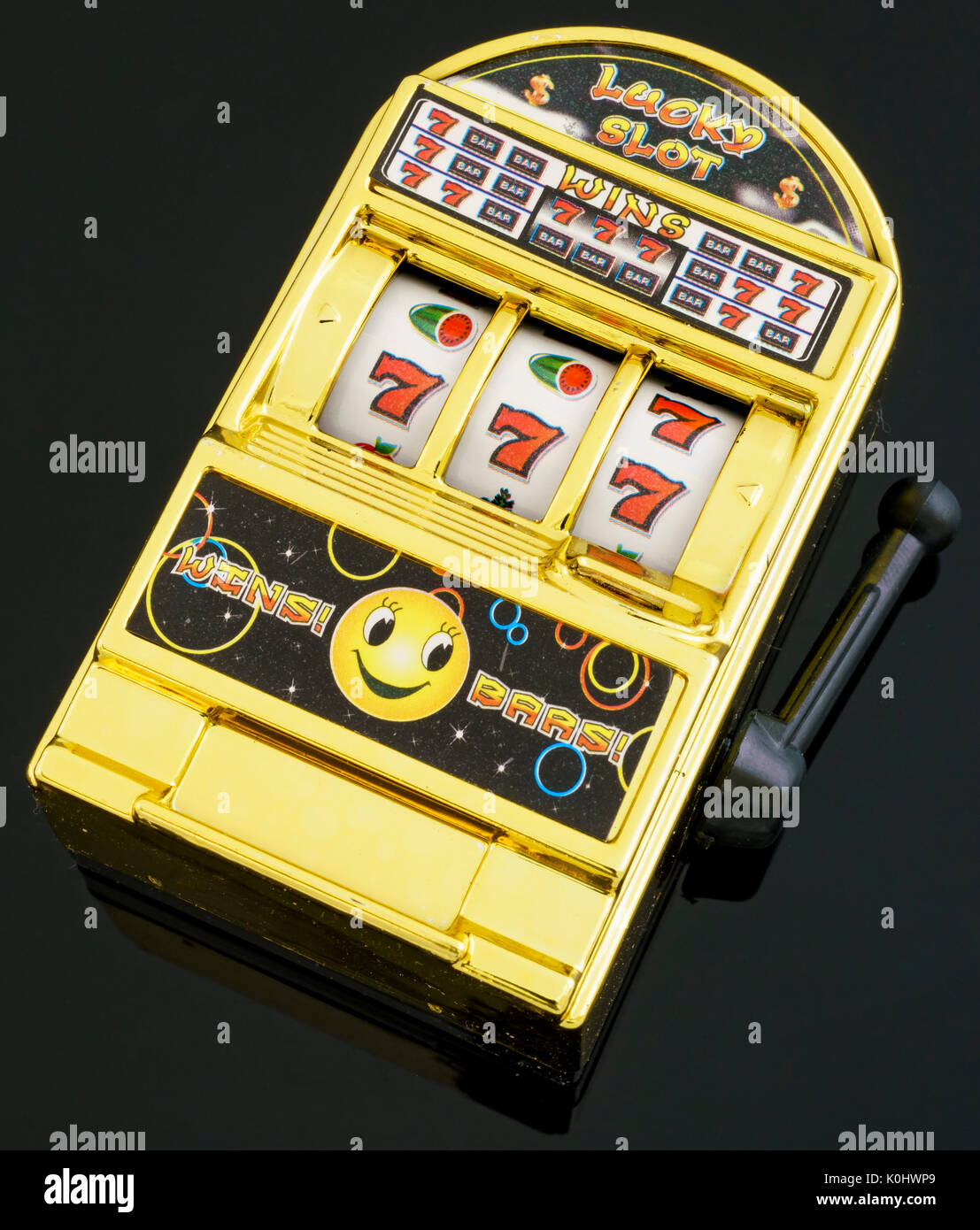 Close up shoot of a gambling model (slot machine) with winning a big prize - Stock Image
