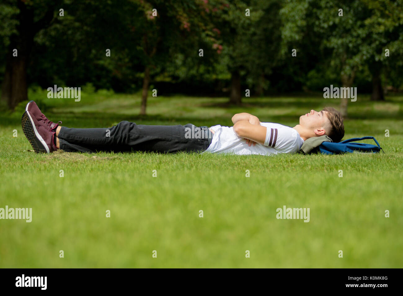 Boy Asleep On Grass Stock Photos Amp Boy Asleep On Grass