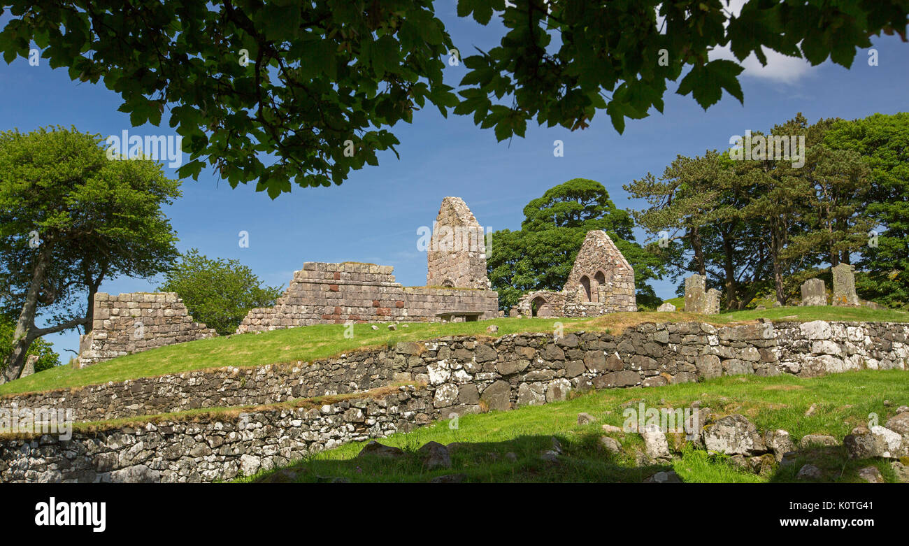 Panoramic view of ruins of historic 13th century Saint Blane's church and monastery against blue sky on island - Stock Image