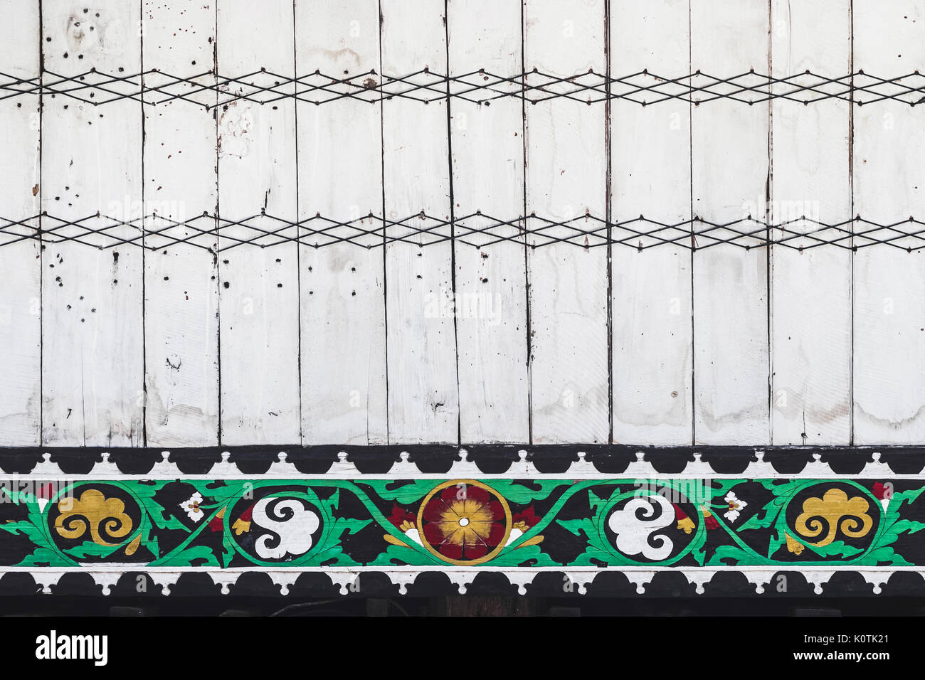 Part of traditional russian house wall with with thread patterns and ornaments. Wooden painted texture - Stock Image