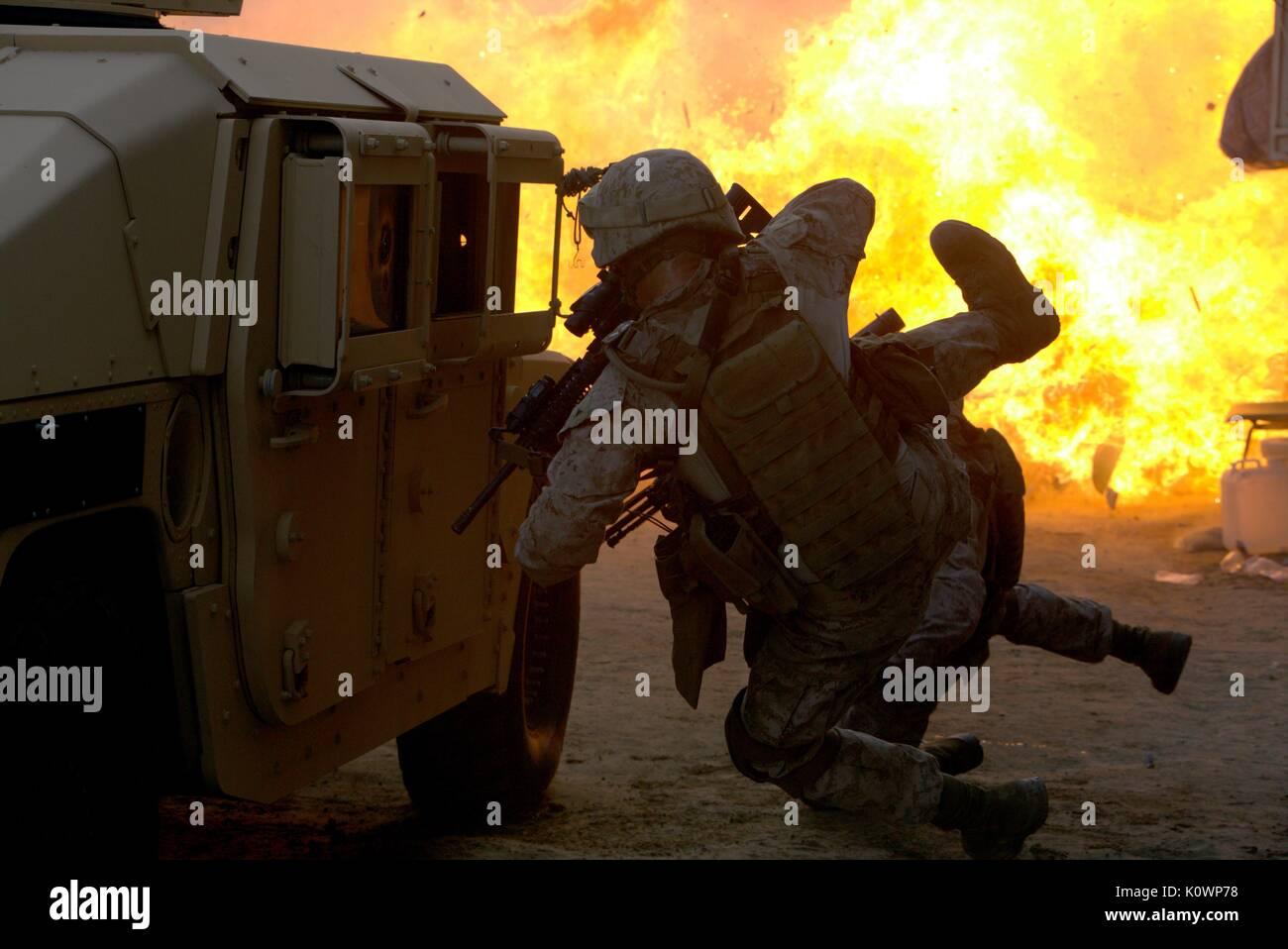 EXPLOSION SCENE MAN DOWN (2015) - Stock Image