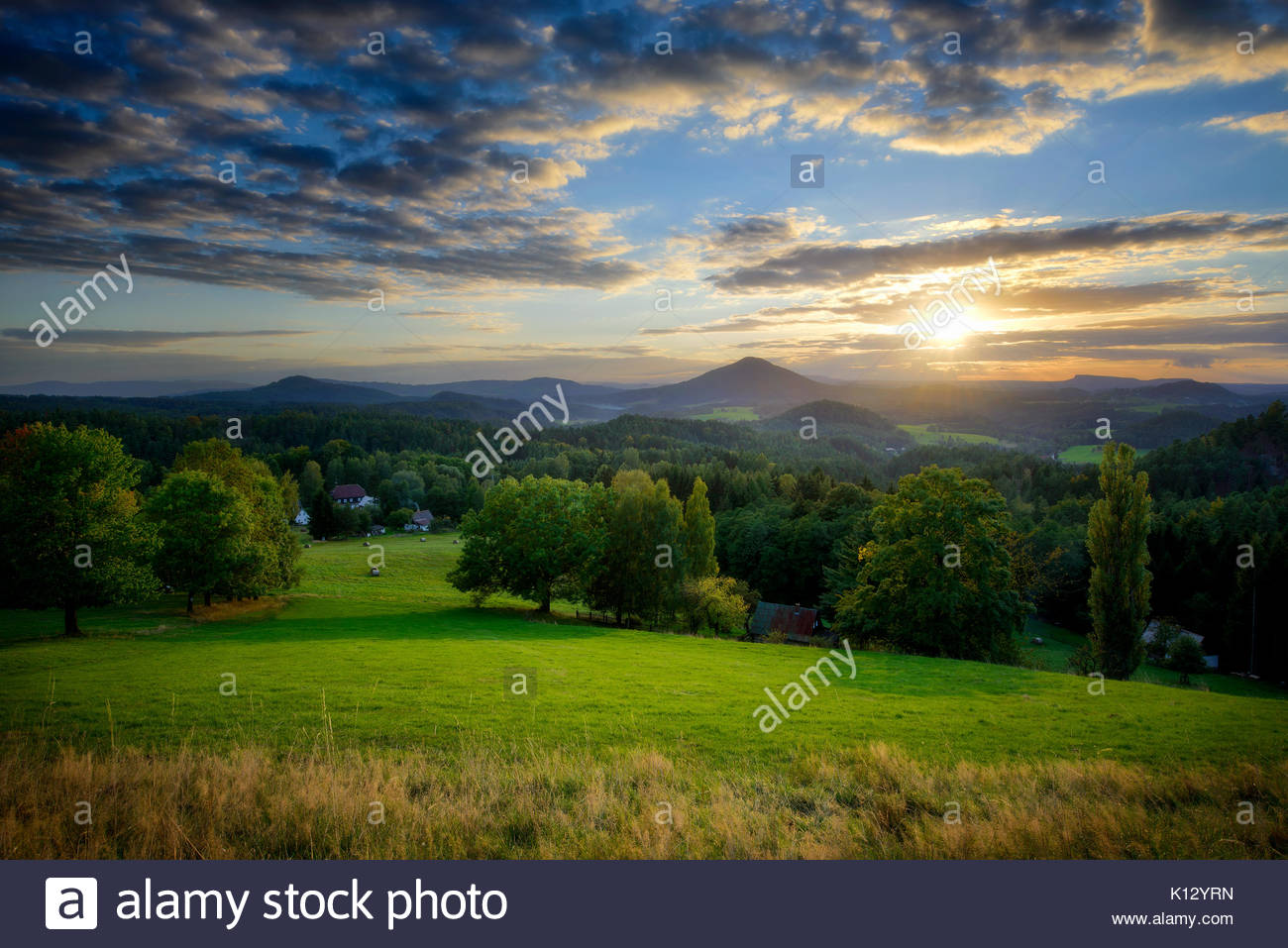 Sunset in Bohemian Switzerland field, Czech republic - Stock Image