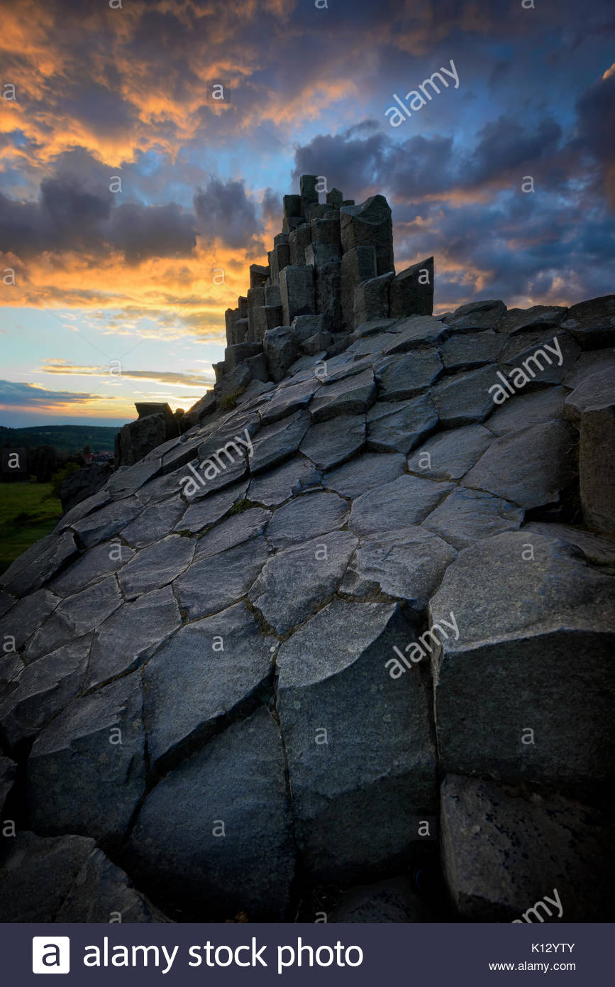 Amazing Chambermaid rock during fiery sunset and beautiful formation of rocks, Central Bohemian Uplands, Czech republic. - Stock Image