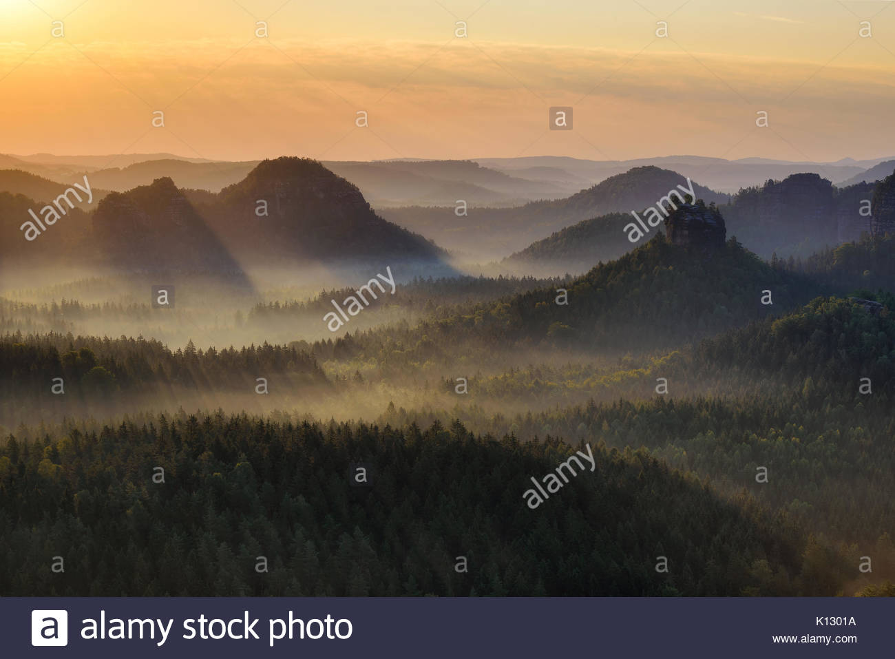 Kleiner Winterberg silhouettes during autumn sunrise, Saxon Switzerland, Germany - Stock Image