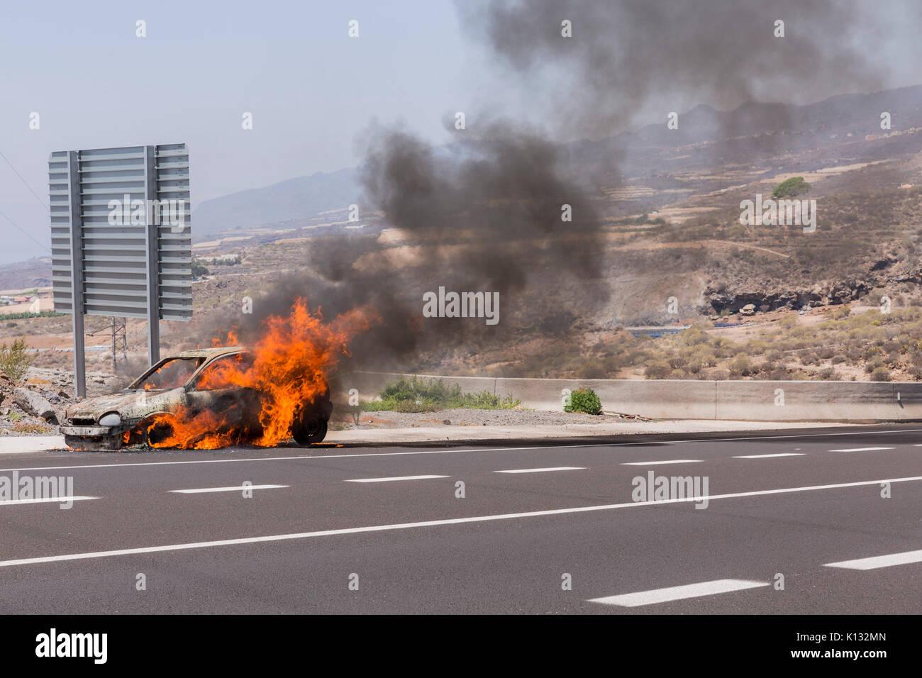 opel-corsa-car-on-fire-by-the-roadside-K