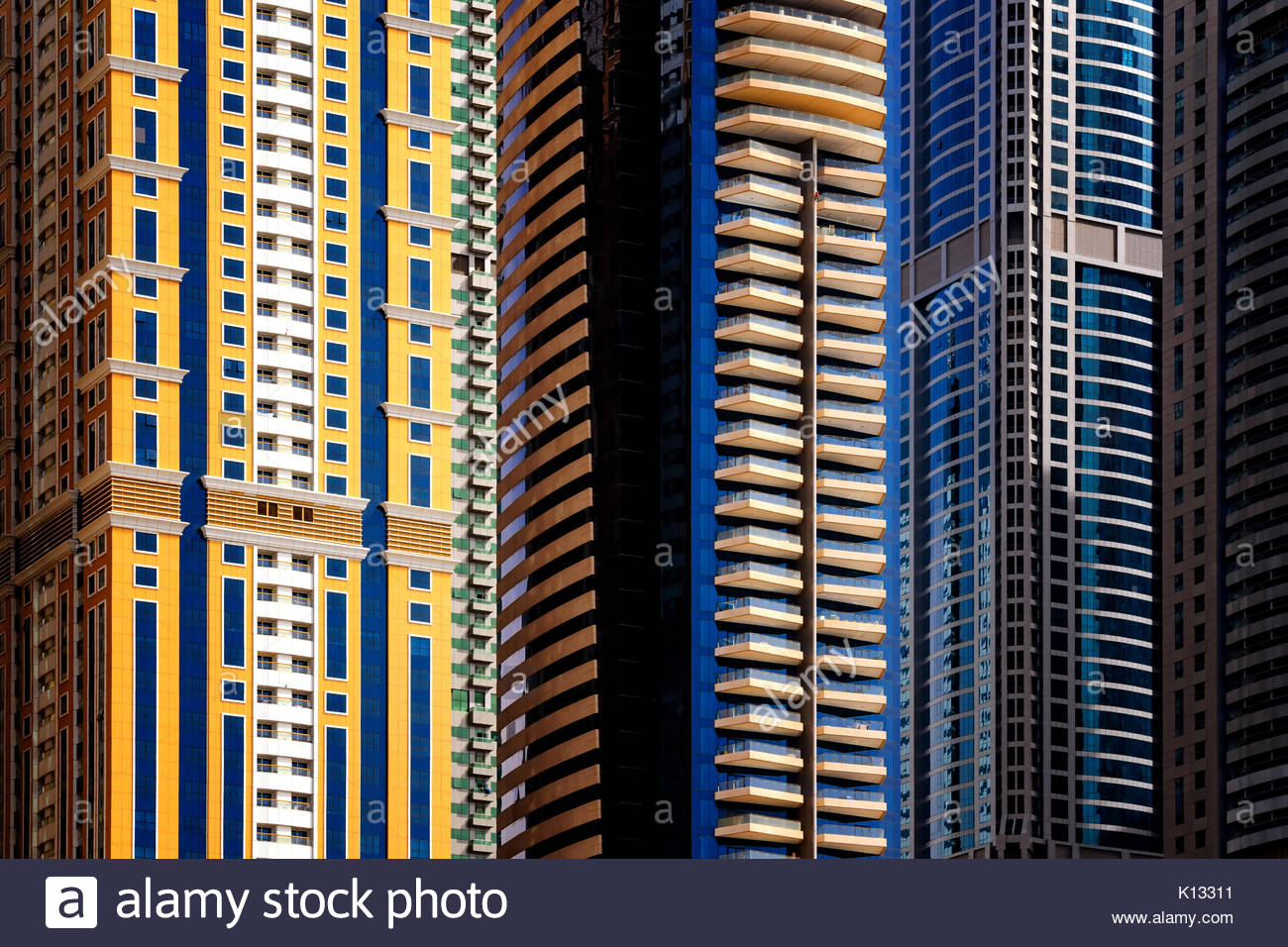 DUBAI, UAE - APR 10, 2013: Majestic colorful dubai marina skyscrapers. Detail of world tallest residential buildings. - Stock Image