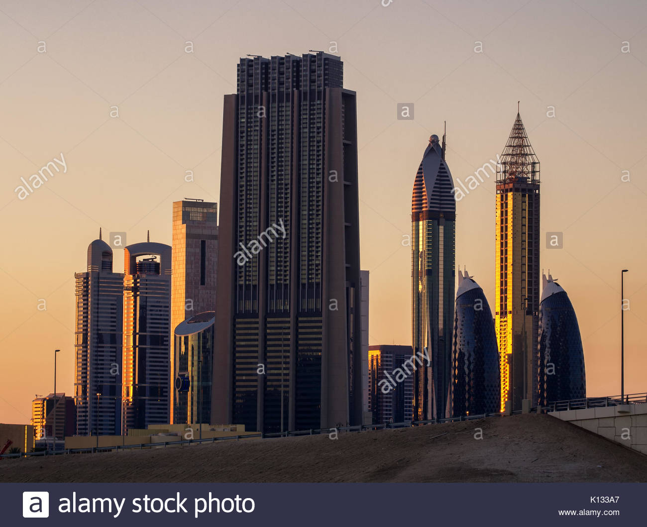 Amazing tallest skyscrapers in Sheikh Zayed road area during beautiful sunset. Downtown summer day. , Downtown, - Stock Image