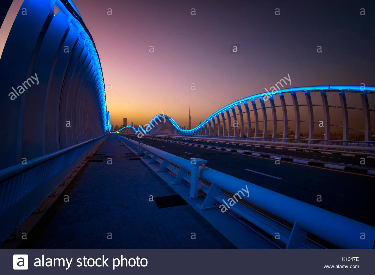 Amazing night dubai VIP bridge with beautiful sunset. Private road to Meydan race course, Dubai, United Arab Emirates - Stock Image