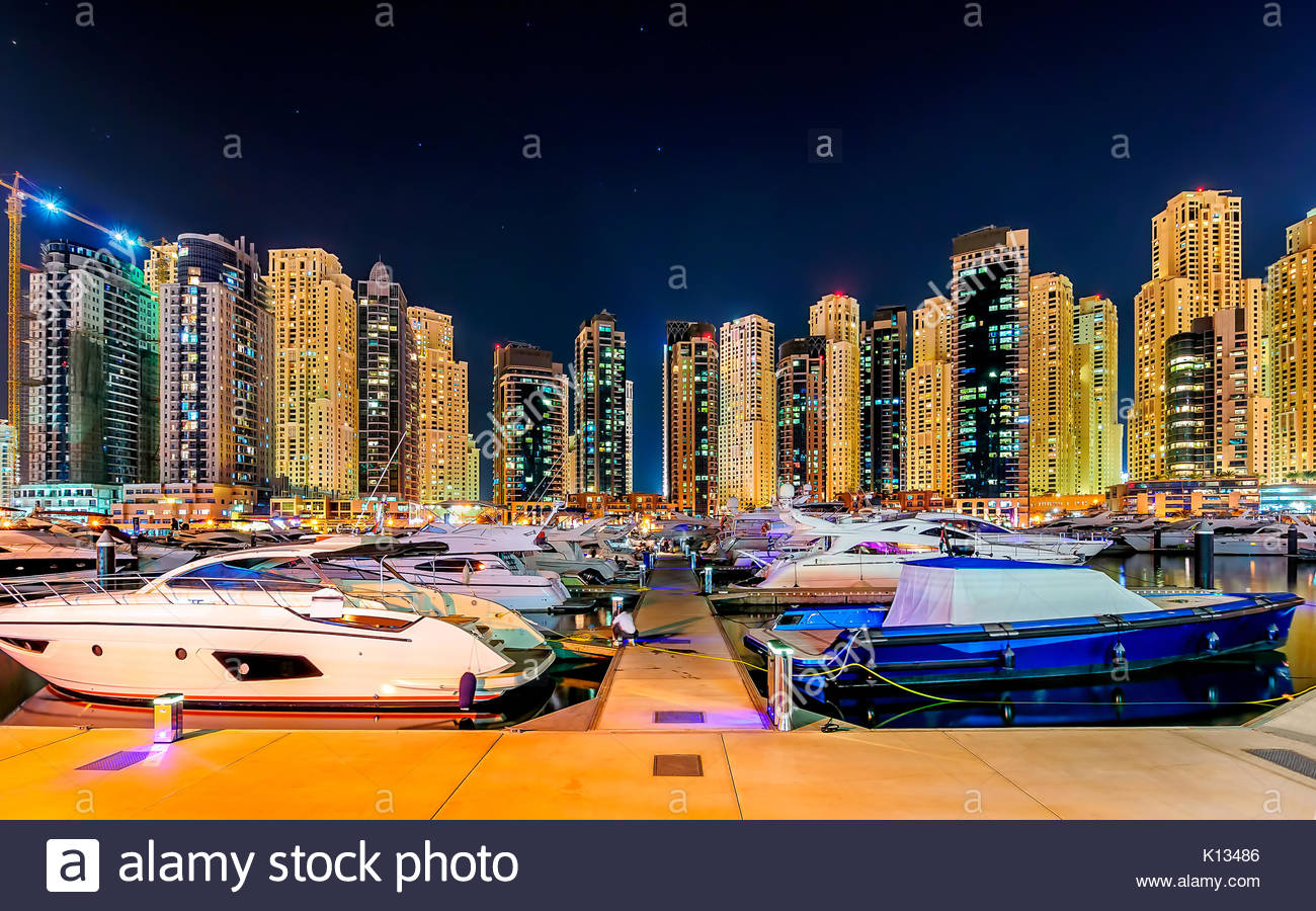 Colorful night dubai marina skyline, Dubai, United Arab Emirates - Stock Image