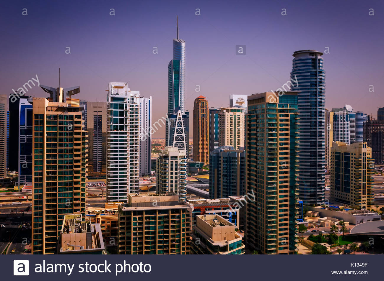 Amazing colorful dubai marina skyline with water canal and expensive yachts during sunny day, Dubai, United Arab - Stock Image