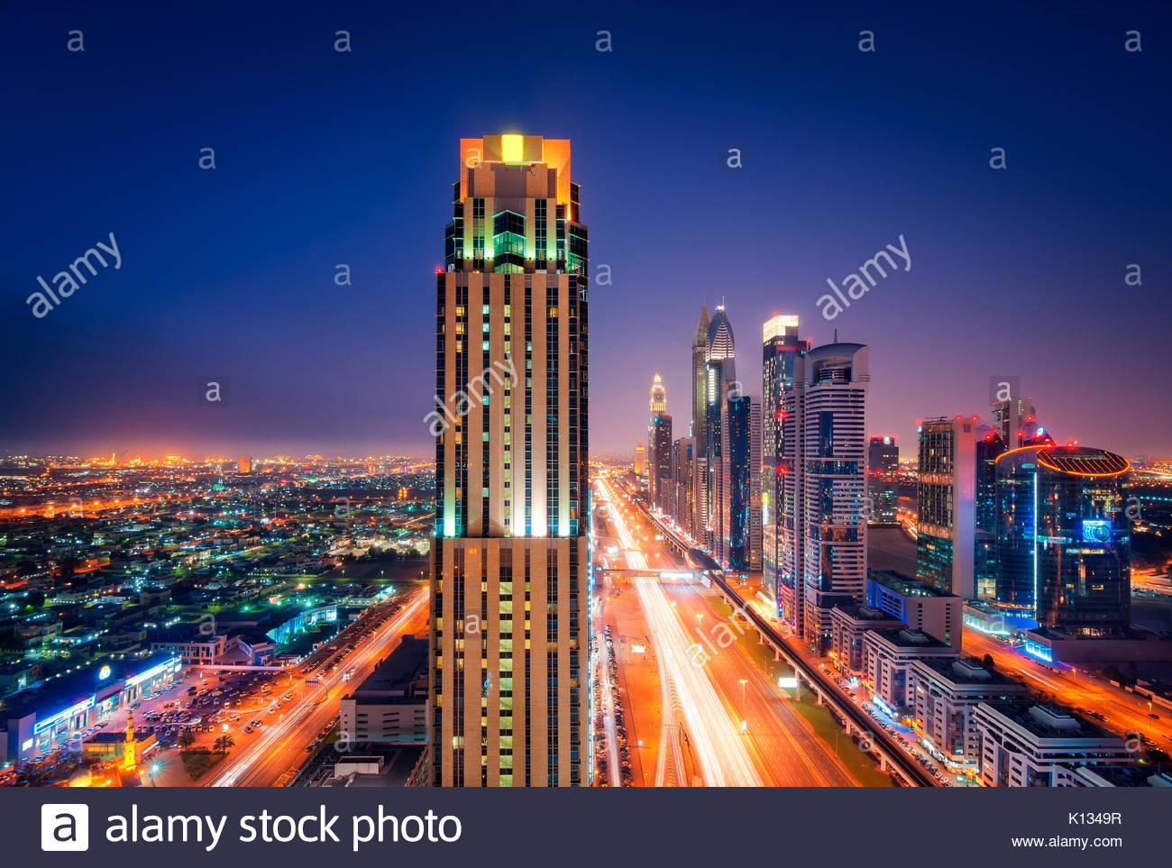 Amazing night dubai downtown skyline with tallest skyscrapers and traffic jam during rush hour, Dubai, United Arab - Stock Image