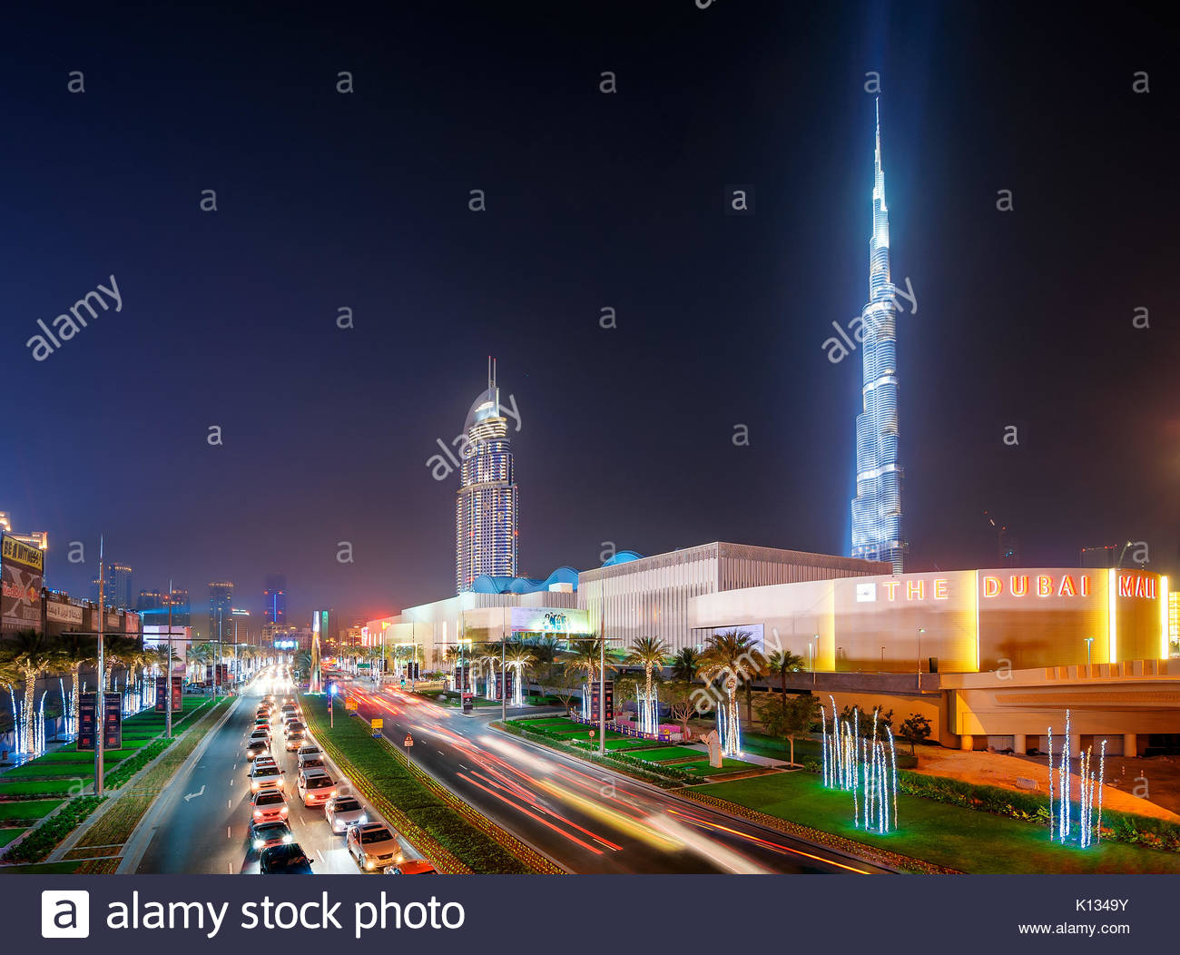 DUBAI, UAE - APR 12, 2013: Amazing night dubai downtown skyline with tallest skyscrapers and biggest shop Dubai - Stock Image