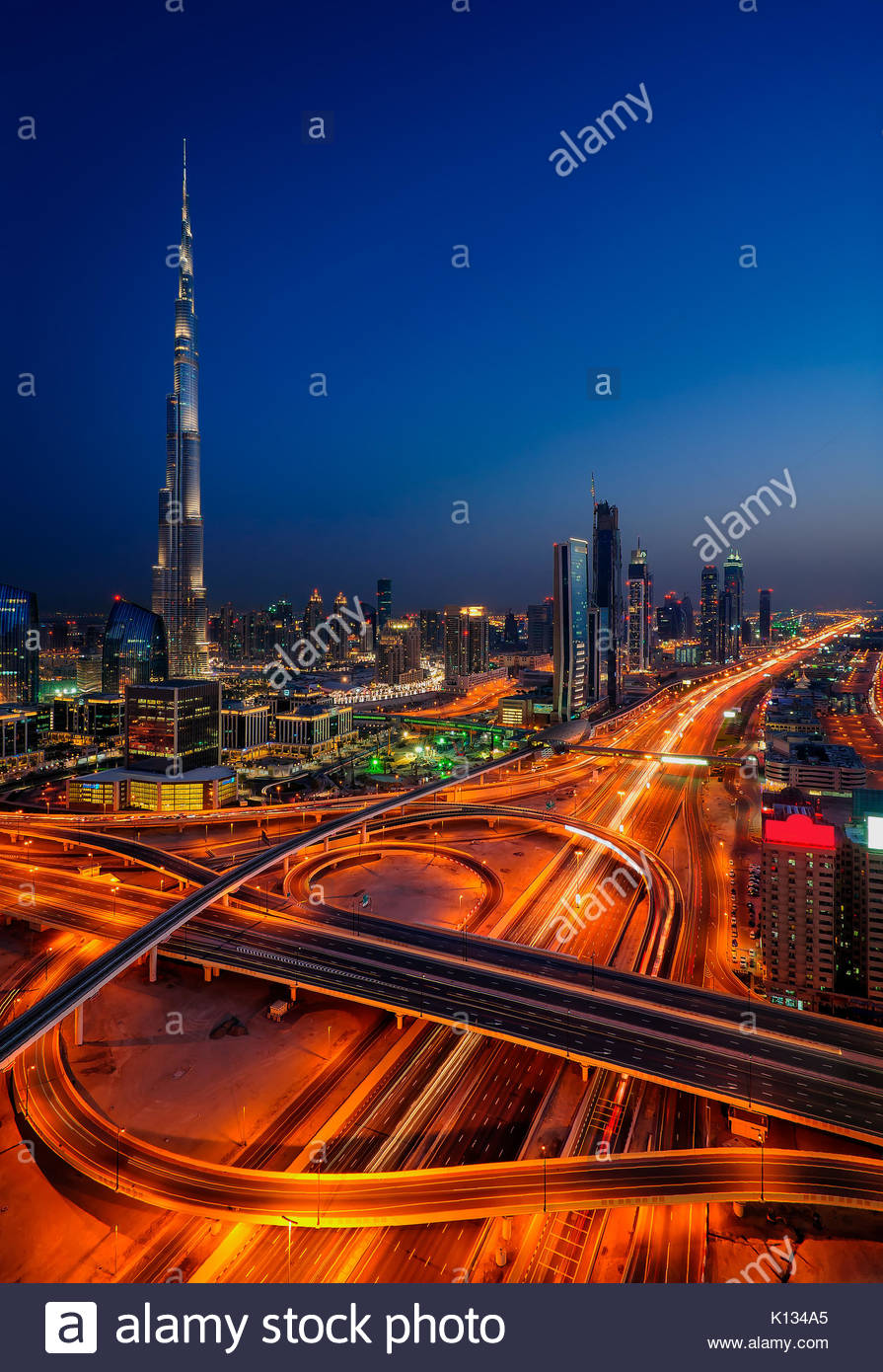 Amazing night dubai downtown skyline with tallest skyscrapers and beautiful sky, Dubai, United Arab Emirates - Stock Image