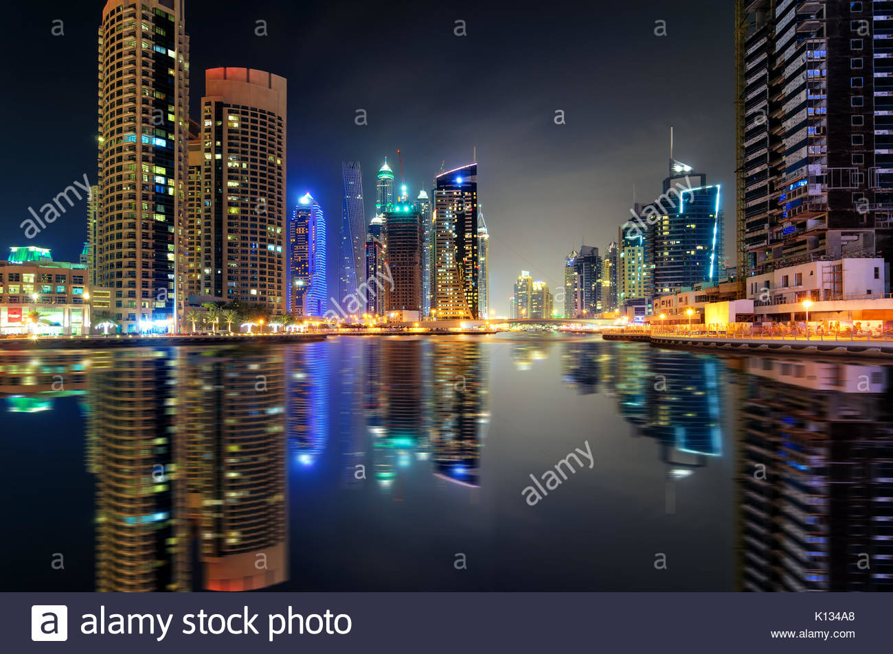 Amazing night dubai marina skyline with tallest skyscrapers and beautiful water reflection, Dubai, United Arab Emirates - Stock Image