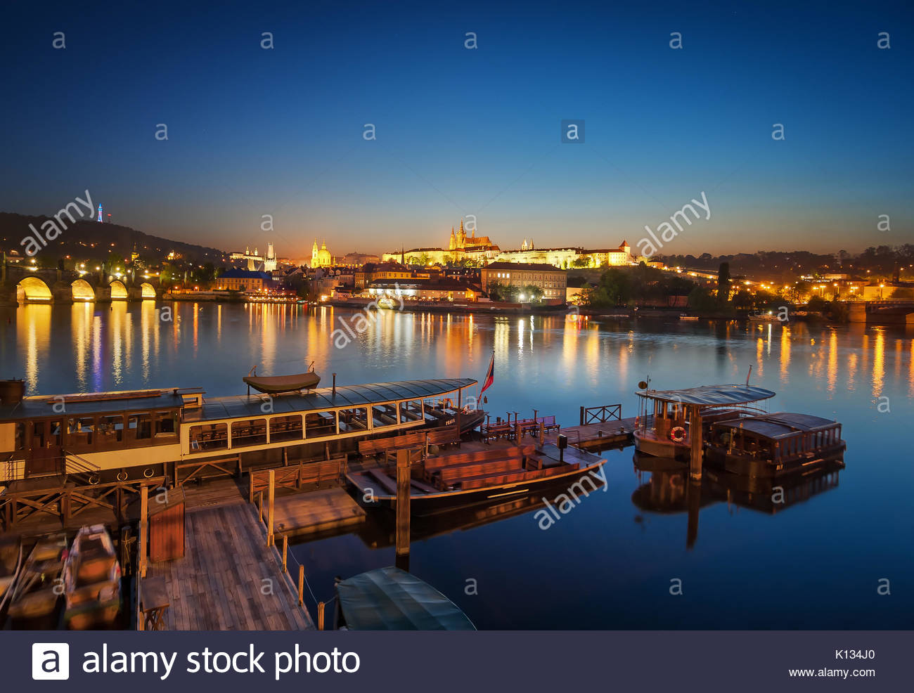 Boat dock during sunset near St. Vitus cathedral, Prague, Czech republic. - Stock Image