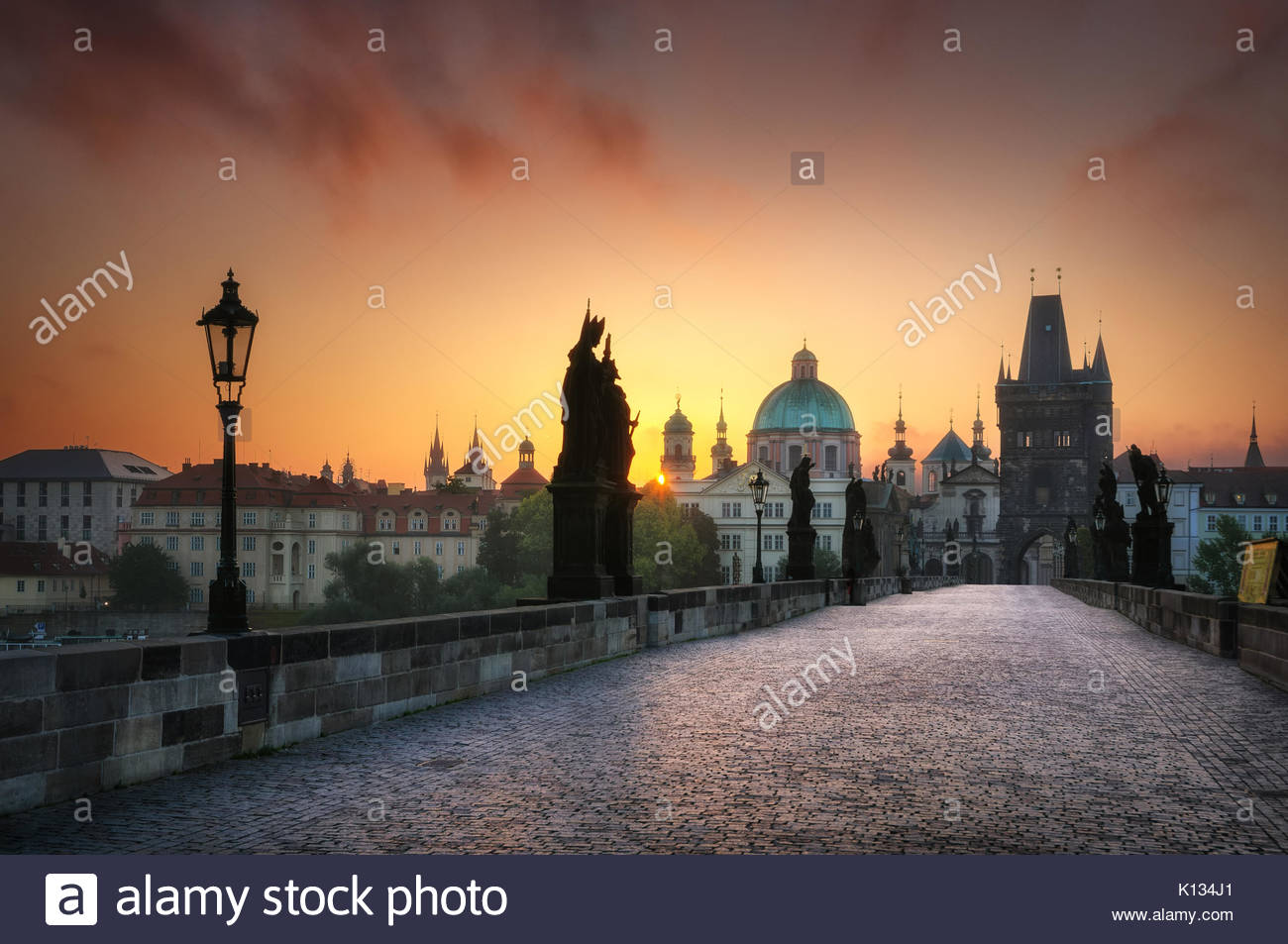 Calm sunrise at Charles bridge without people, Prague, Czech republic - Stock Image