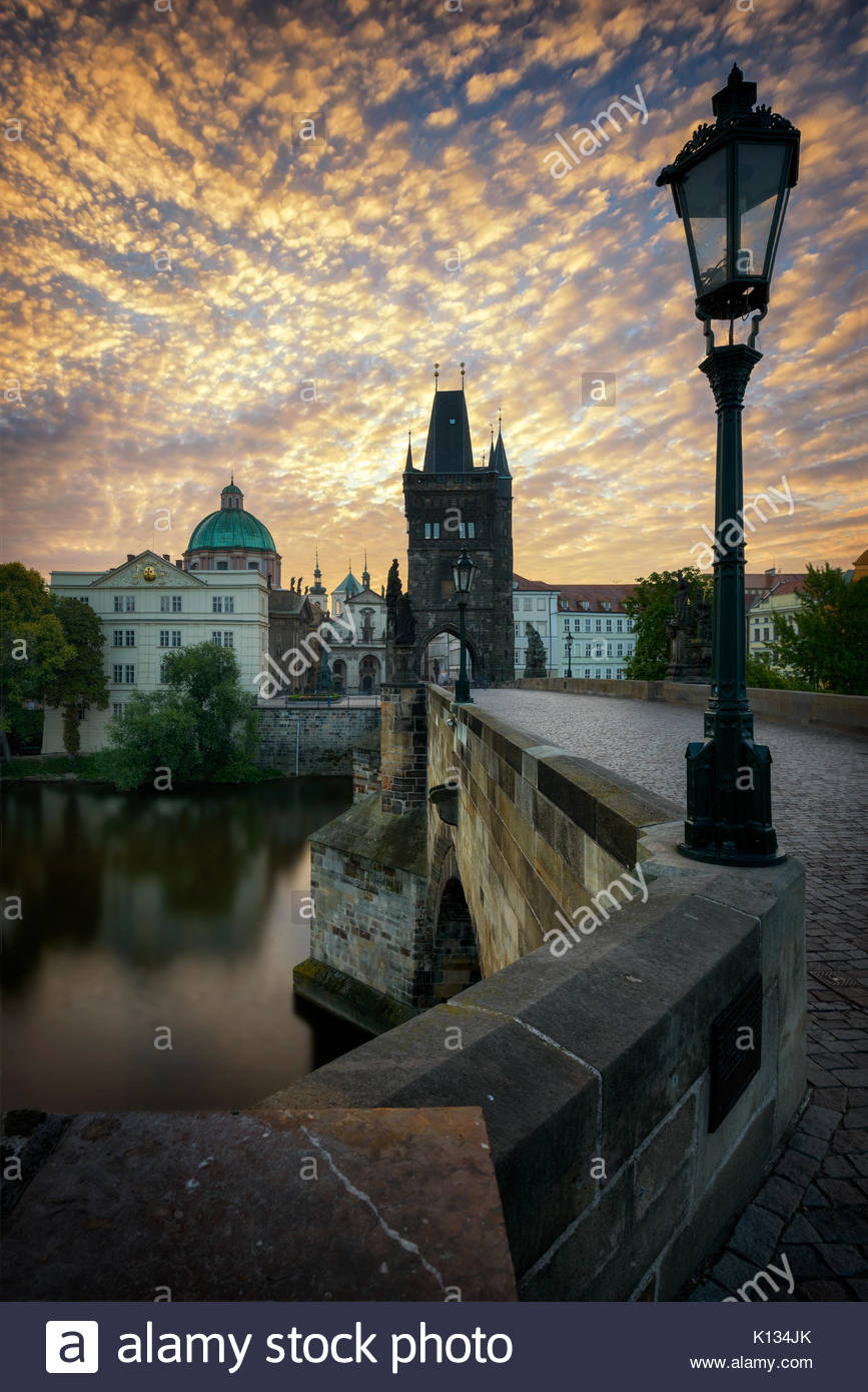 Sunrise at Charles bridge in Prague, Czech republic - Stock Image