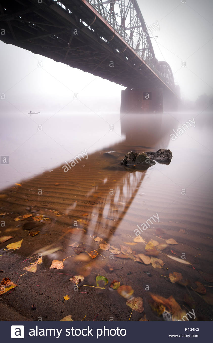 Railway bridge during foggy morning in Prague, Czech republic - Stock Image