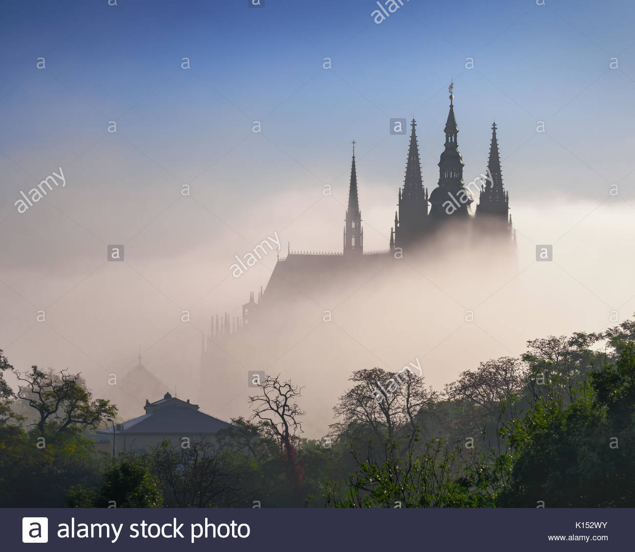 Fog waves over St. Vitus Cathedral during autumn, Czech republic. - Stock Image