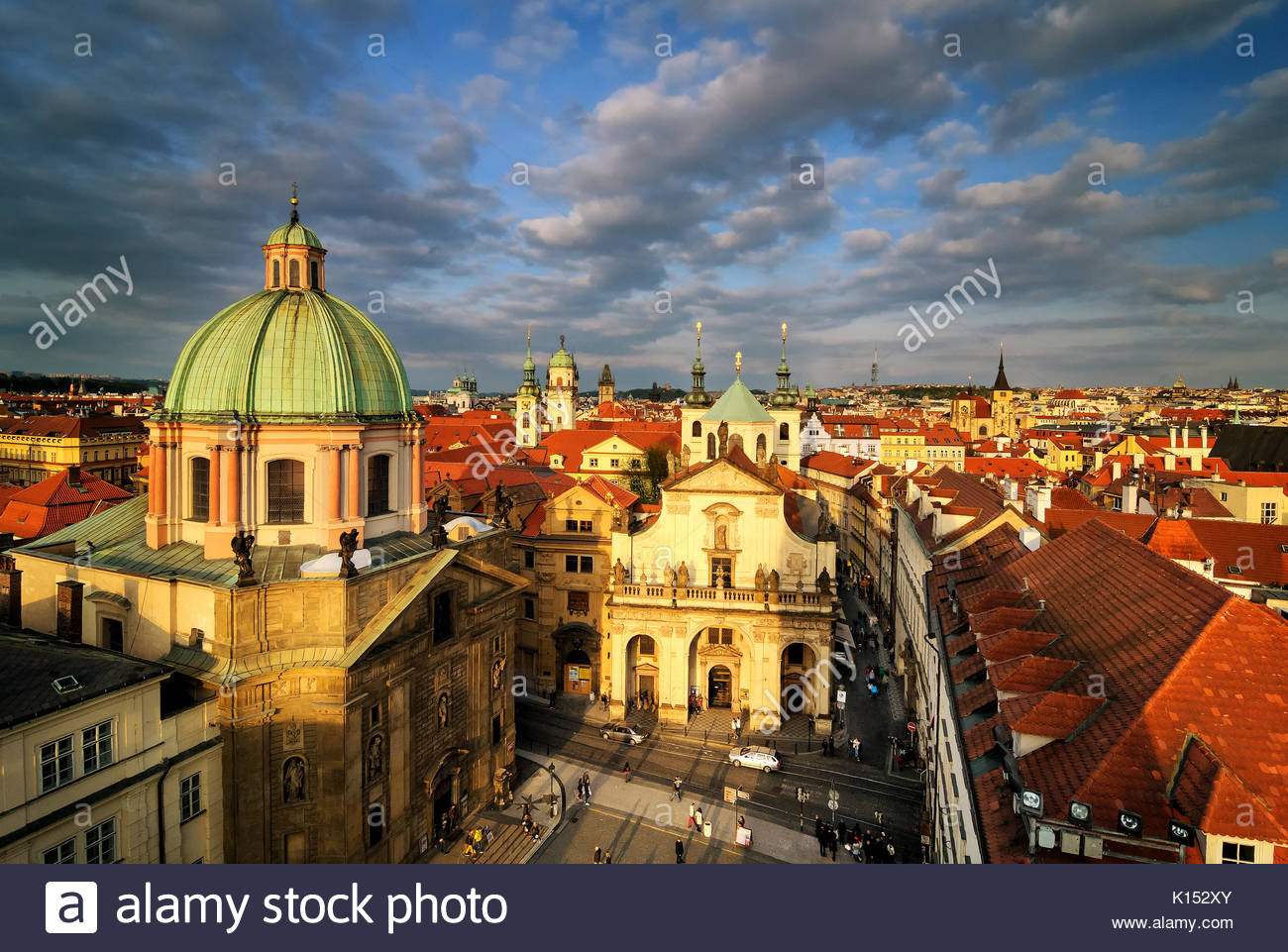 Sunset view at Square of the Knights of the Cross with heavy clouds, Prague, Czech republic - Stock Image