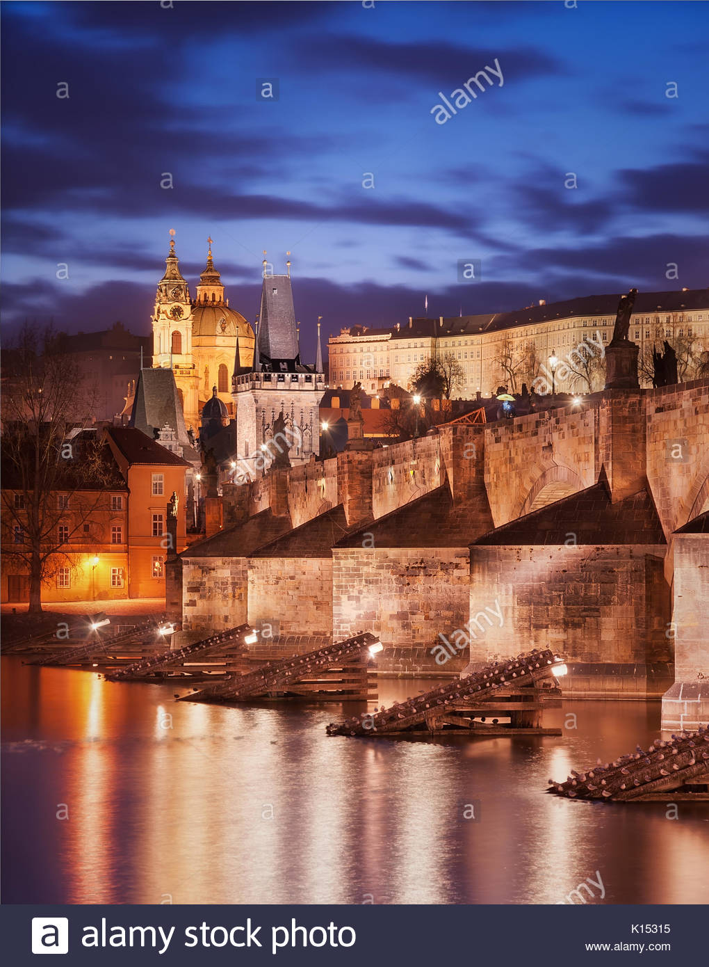 Charles bridge and St. Vitus cathedral view during sunset, Prague, Czech republic - Stock Image