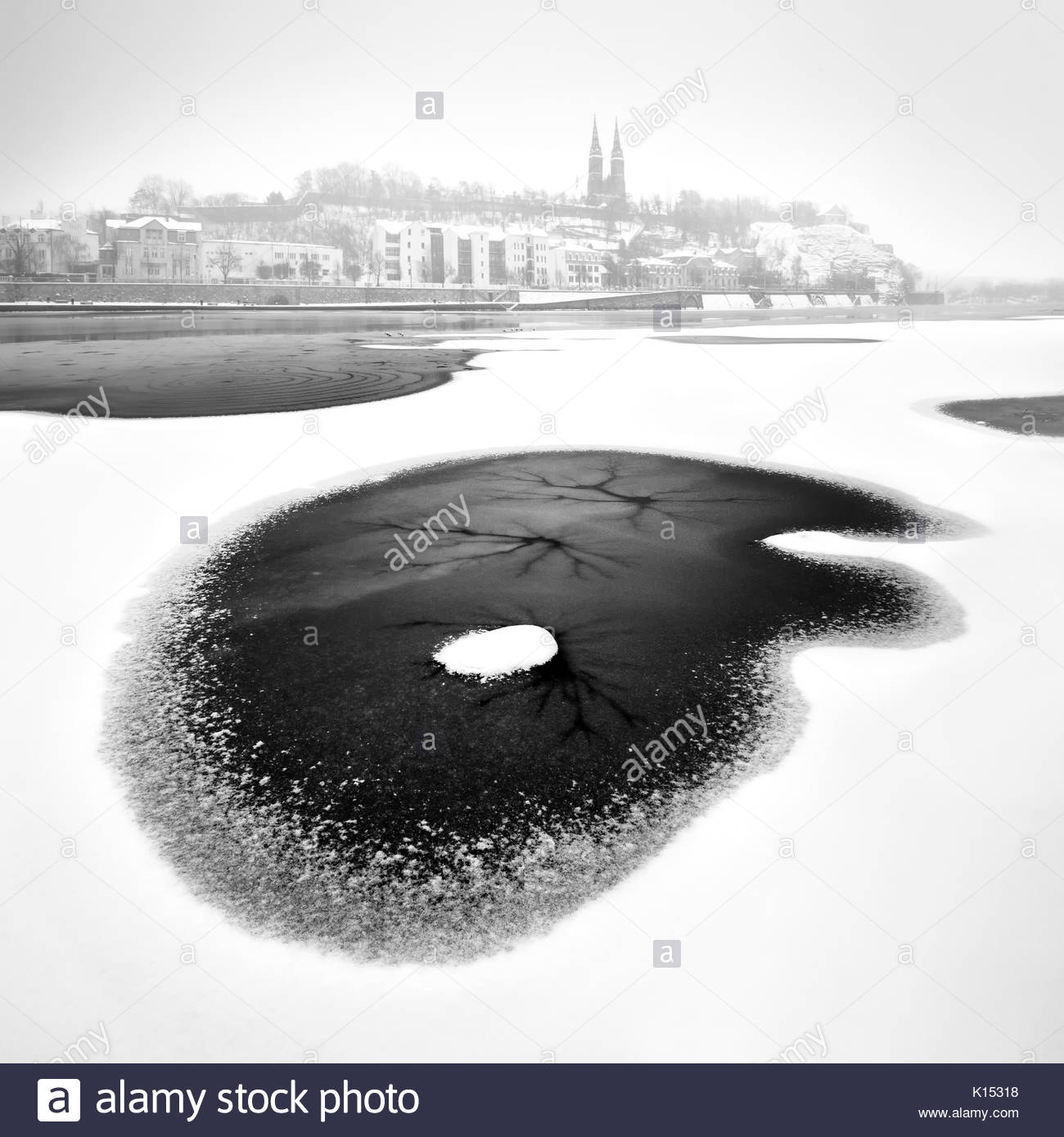 Vysehrad church during winter time with frozen river, Prague, Czech republic - Stock Image