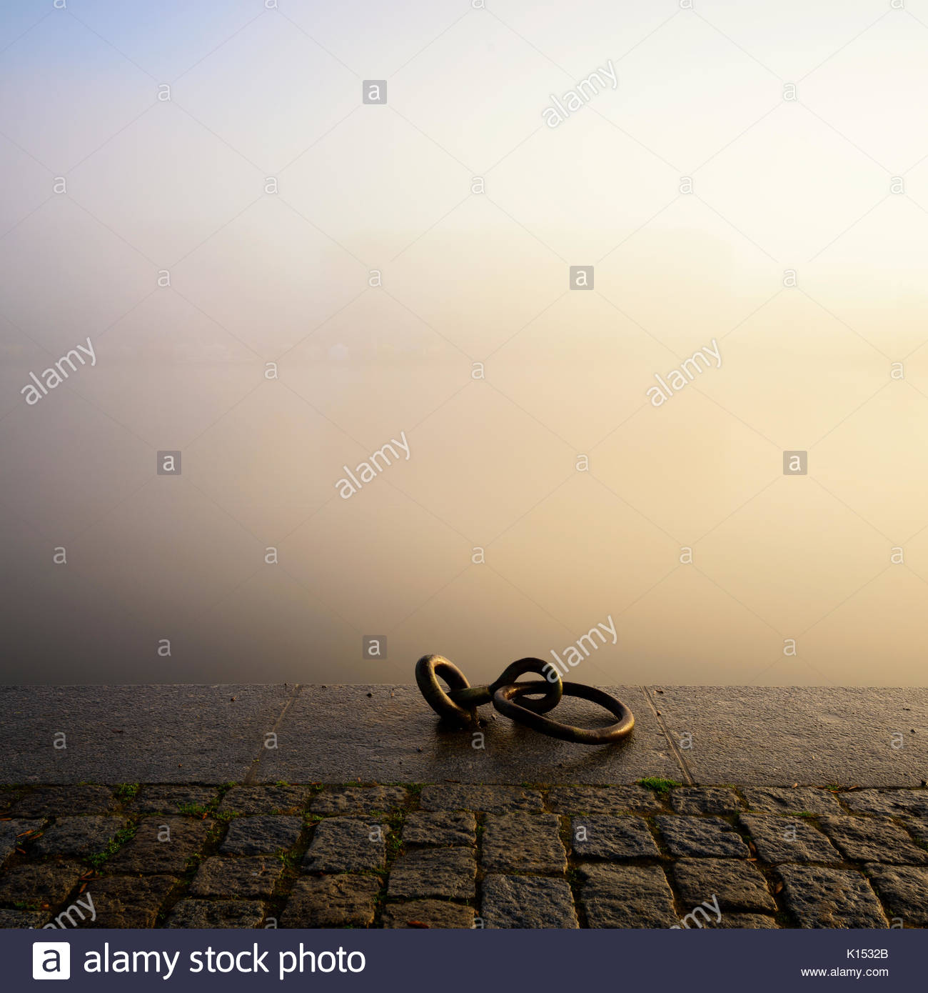 Riverbank near Vltava river during foggy morning, Prague, Czech republic - Stock Image